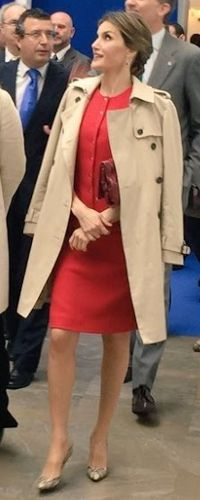 10 May 2016 - Queen Letizia visits Aerospace Incubator Centre. For the event Doña Letizia wore a Carolina Herrera trench coat, under the coat, red Nina Ricci separates, Carolina Herrera 'Maysa' bag and python pumps, and ruby and diamond dangle earrings.