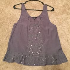 American Eagle sequin design tank top this American eagle brand tank top is embellished with sequins/beads. the bottom flairs out a little American Eagle Outfitters Tops Tank Tops