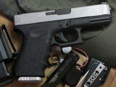 Custom Glock G19 (9mm). Lone Wolf Distributors slide - frame customization by Robar - GL101O sights by Trijicon