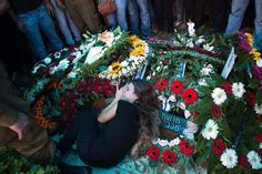 The girlfriend of Israeli soldier Tal Yifrah mourns as she lies atop his grave during his funeral in Rishon Lezion near Tel Aviv, July 22, 2014. REUTERS/Ronen Zvulun