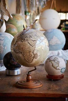 One of the World's Only Globe-Making Studios Celebrates the Ancient Art of Handcrafted Globes - My Modern Met Globe Bar, Map Globe, Edible Water Bottle, Globe Decor, World Globes, Ancient Art, Cool Artwork, Oeuvre D'art, Decoration