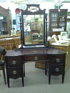 $265 - This vintage mahogany vanity has 5 drawers and an adjustable mirror. Original Hardware is complete. The vanity measures 47 inches across the front, 18 inches deep and it stands 27 inches tall . The mirror adds an additional 39 inches in height. It can be seen in booth D 3 at Main Street Antique Mall 7260 East Main St ( E of Power Rd ) Mesa 85207  480 9241122open 7 days 10 till 530  Cash or charge 30 day layaway also available