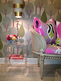 color and vignettes. Vintage chair in bright fabrics. Lucite end table. Over the top wallpaper.