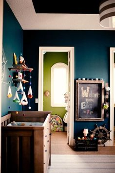 This is a nursery... But I adore the colour of the wall! Would flatter dark wood furniture, which I have.