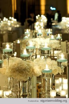 25 Stunning Candle Centerpiece love the idea of mirrors to gain reflection of light