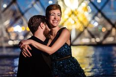 Looking for fabulously romantic Blue Hour Paris engagement photos at the Louvre Museum? Well, you're not alone. Here's the deal. Hire a talented Paris photographer who does not use flash (only continuous light sources will achieve the desired results!), show up during the summer months, when the fountains are on, and wait until about 15-20 minutes after official sunset for the sky to turn increasingly blue and vivid. Enjoy!