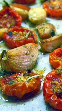 Slow Smoked Tomatoes and Garlic... I smoked these in a BBQ Grill/Smoker.  BUT you can slow roast them in an oven.  Very easy and Sooo useful.  the make amazing pizza toppings, salad accents, Serve on toast or let your imagination run.  Slow Roasting brings out the candy sweetness in the garlic AND the little tomatoes... little gems