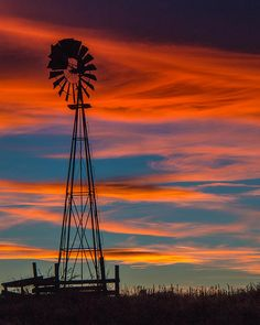 Rustic Windmill Silhouetted Against Orange and Blue Sunset Windmill Art, Old Windmills, Outdoor Pictures, Cool Pictures, Minecraft House Designs, Sunset Background, Country Scenes, Water Tower, Sunset Sky