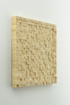 Handmade wooden wall art. How created? As you can see this product is made of many pieces of wood. These are handmade and painted. These cubes are made one by one in a pre-conceived pattern and piece by piece glued. The nice thing is that the cubes, because they are worked by hand have