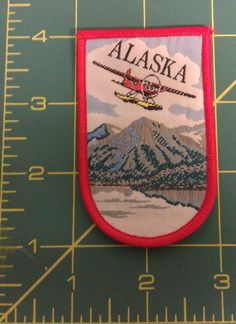 Old Alaska Woven cloth iron on patch Float plane & mountain  hard to find item!
