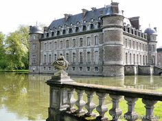 """Beloeil Castle, Belgium; The word """"Beloeil"""" literally means Beautiful eye.  Founded in the 13th century as a medieval fortress, it is one of the biggest and most beautiful castles in Belgium.  It later became a residential palace in the 17th and 18th century.  Since 1394, the castle has belonged to the Princes of Ligne, one of Belgium's highest ranking noble families.  Every year for one week in the spring the castle holds a floral show."""