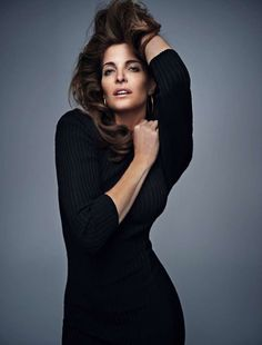 Model Stephanie Seymour wears little black dress made of ribbed knit for ELLE Magazine Spain October 2016 editorial