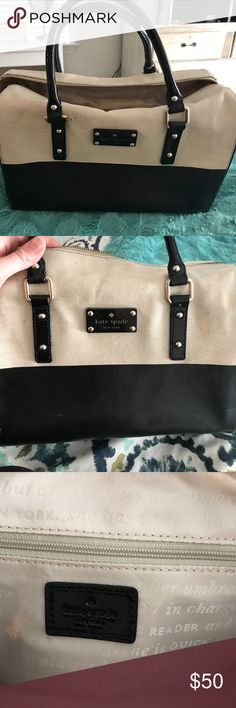 Kate Spade bag Great Kate Spade Black and Tan canvas purse. Lightly used - few scratches see pic. Great water resistant material and very spacious kate spade Bags Totes