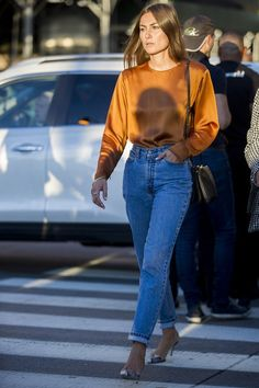 Denim jeans given an autumnal update with an amber orange satin top tucked in