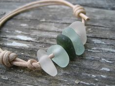 Five pieces of genuine frosty light blue California-found sea glass strung on a natural colored leather cord. This bracelet is adjustable from about 6 1/2 inches to around 11 inches. All five pieces of sea glass were found in Monterey, California on historic Cannery Row.