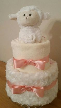 2 tier Nappy Cake by April Showers Nappy Cakes Derbyshire. Baby Shower Nappy Cake, Baby Nappy Cakes, Idee Baby Shower, Diy Diaper Cake, Shower Bebe, Baby Shower Diapers, Baby Boy Shower, Baby Shower Gifts, Baby Gift Hampers