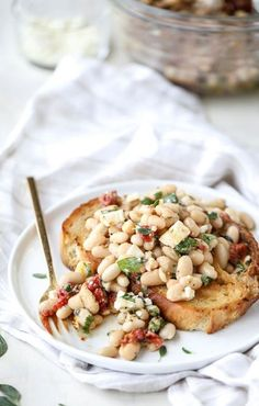 Enjoy the flavors of the Mediterranean for lunch with this recipe for Marinated White Beans with Olive Oil Toast. Grab the feta cheese, roasted red peppers, sun dried tomatoes, basil, and cilantro to start seasoning your dish!