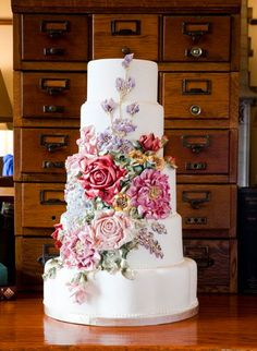 Tiered White Cake Featuring Colorful Multitude of Sugar Flowers