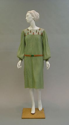 Ensemble Paul Poiret (French, Paris 1879–1944 Paris) Date: 1925–26 Culture: French Medium: wool, metal, leather Dimensions: Length at CB (a): 41 3/4 in. (106 cm) Length at CB (b): 26 1/4 in. (66.7 cm) Credit Line: Gift of Mrs. C. O. Kalman, 1979 Accession Number: 1979.569.6a–c