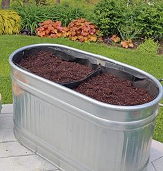 Smart Pots make great liners for large containers. Here a metal feed/water trough is being turned into a planter.