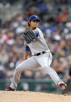 DETROIT, MI - APRIL 19: Yu Darvish #11 of the Texas Rangers pitches in the first inning of the game against the Detroit Tigers at Comerica Park on April 19, 2012 in Detroit, Michigan.  (Photo by Leon Halip/Getty Images) game 13