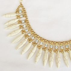 Feather-effect adorable white statement necklace Super cute statement necklace with marbled feather-like beads. Fashion jewelry, with cute rhinestone accents. Looks great with a solid shirt to really make this piece pop! ❤️Multiple in stock, please request a new listing for purchase!❤️ Jewelry Necklaces