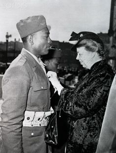 First Lady Eleanor Roosevelt pins the Soldier's Medal on Private Sam Morris at a ceremony in Seattle in April 1943. Morris saved the lives of several people trapped in a burning packing plant when a bomber crashed into the building.