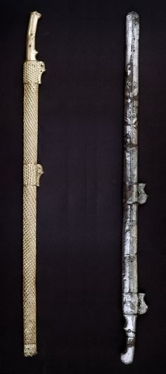 Iron sword with silver hilt and scabbard; originally suspended from the pair of R-shaped mounts.