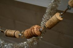 DIY Idea: Wine Lover's Holiday Garland    Just insert small eye screws into both ends of each cork and tie them together with jute.