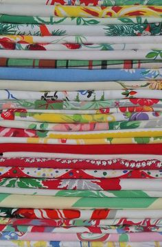 Vintage yard goods....My Mother made tablecloths and curtains with fabrics very much like these yard goods! Everything always had a pop of color in our mid-century kitchen.
