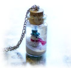 *Bottle necklace, snowman and a winter wonderland scene, snow globe, bottle pendant
