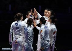 China's athletes and Romania's athletes greet with each other prior to women's epee team gold medal match of fencing at the 2016 Rio Olympic Games in Rio de Janeiro, Brazil, on Aug. 11, 2016. Romania won the gold medal.  http://www.chinasportsbeat.com/2016/08/defending-chinas-womens-epee-team.html
