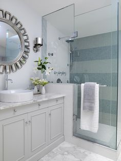 The right hardware takes your bathroom to the next level. Designer Sarah Richardson of Sarah's House selects sleek chrome shower fixtures and faucets for this contemporary bathroom. To create a refined style, she uses glass mosaic tiles in the shower and a marble countertop for the vanity.