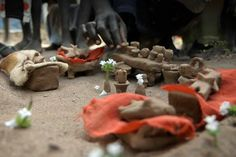 In a refugee camp in South Sudan, children make a dollhouse to tell their story of war.
