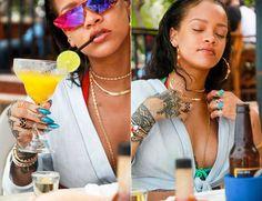 Rihanna Lisa Marie Fernandez tie front top, Ipanema reversible rainbow bikini top, Dior Rihanna red shield sunglasses, Horsenbuhs long tri-link necklace,  Jacquie Aiche gemstone hoop earrings, petal stack ring, vertical kite ring, 3x3 diamond cluster ring, onyx eternity band, Chopard happy hearts bracelet