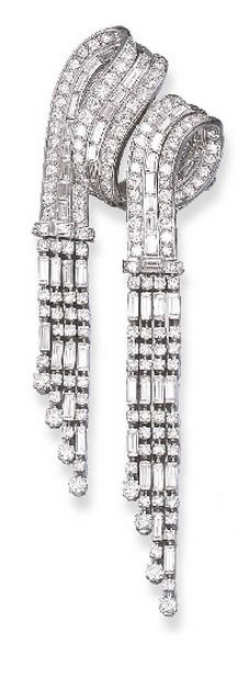 A DIAMOND BROOCH  Designed as circular and baguette-cut diamond scrolled ribbons with diamond tassel terminals, circa 1940