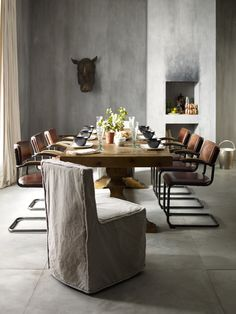 This dining  room will leave and impression. Hughes | Furniture Collections - Four Hands