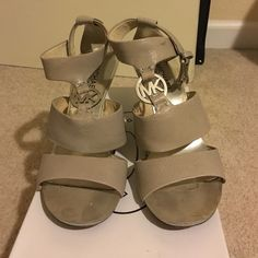 Michael Kors wedges Silver sandal with Michael Kors logo emblem on a black wedge Michael Kors Shoes Wedges