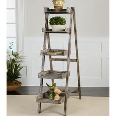 Create a rustic design in your welcoming home decor with this easel style folding bookshelf. The frame and five wooden shelves are stained in a weathered, sun faded charcoal finish that beautifully displays layers of hand-distressing.