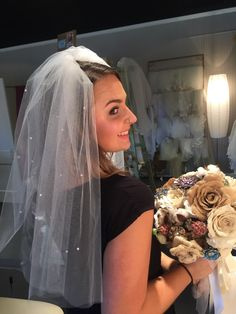 this is our receptionist Peyton modelling one of our veils..this one is ivory, elbow length with a raw edge and scattered pearls. We have it for only $150! #veils #bridal #midsouthbride #bridalaccessories