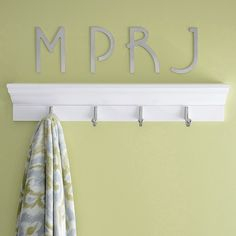 Keep your family bathroom organized. A row of towel hooks creates a spot for robes and linens. Stainless steel initials identify each towel owner.