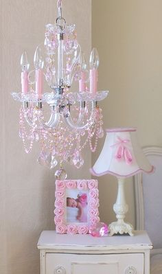 I really like the white furniture for a little girls room. And the chandelier is to die for!