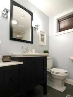 After the renovation, the bathroom looks brighter and much more open. Light blue walls create a calming effect, and with overall less clutter, the entire space feels larger.