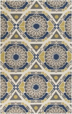 The dazzling pattern featured on this flat weave rug is both floral and geometric. Blue seems to sing with the yellow, gray, and beige. From the Kaleidoscope Collection from Surya. (KAL-8003)