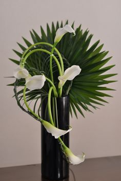 greenery and calla lilies More