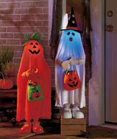 """Delightful color-changing Halloween Trick-or-Treater looks like a costumed child. Standing about 3 feet tall, it wears a draping """"costume"""" and holds a jack-o'-lantern treat bag. The head lights up and changes from shades of red to green to blue under"""