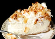Triple Coconut Cheesecake....YUMMY!!!!!  This is a coconut lover's dream...and it really should be called quadruple coconut cheesecake if you count the toasted coconut on top.  This cocolicious dessert consists of a coconut crust, coconut cheesecake filling and coconut whipped cream!!!