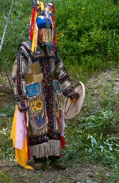 This is a photo of Chuonnasuan (1927–2000), the last shaman of the Oroqen people, taken by Richard Noll in July 1994 in Manchuria near the Amur River border between the People's Republic of China and Russia (Siberia). Oroqen shamanism is now extinct.