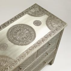 Crafted of mango wood wrapped in hand-embossed metal, our Kiran Embossed Metal Dresser is rich with character and versatility. It features a medallion motif, four roomy drawers and a premium-quality finish treatment, making this World Market exclusive a must-have piece a at a very affordable price.
