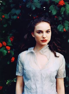 Natalie Portman Natalie's perfect complexion. The shadow framing behind her is exceptional, the saturation is beautiful, the red roses and lips make the picture.